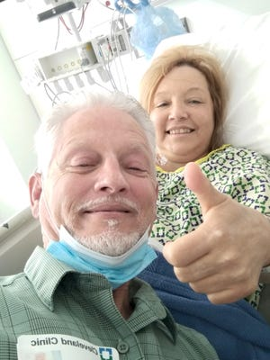 Yvonne Cooperider poses with her husband, Tracey Cooperider after her heart transplant surgery. Performed on Feb. 17, the operation lasted eight hours.