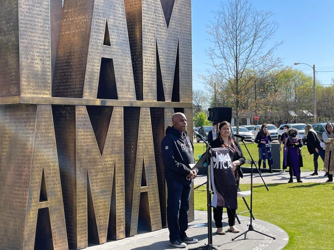 Rev. Byron Moore of Saint Andrew A.M.E Church and Elizabeth Barrios, a Spanish-language interpreter, stand at I am a Man Plaza on April, 2, 2021.