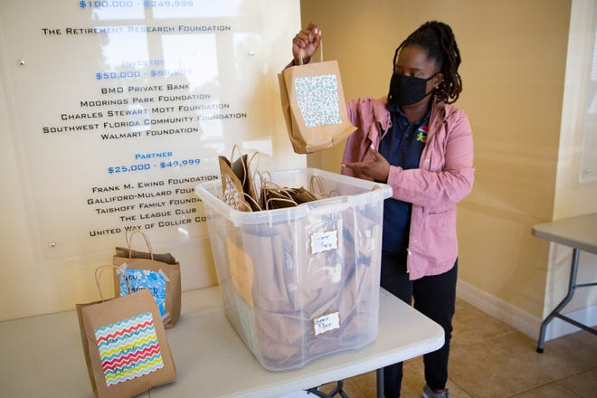 Jacquela Cameron, middle school site coordinator at Grace Place for Children & Families drops off a box filled with care packages for Naples Senior Center members on Friday, April 2, 2021.