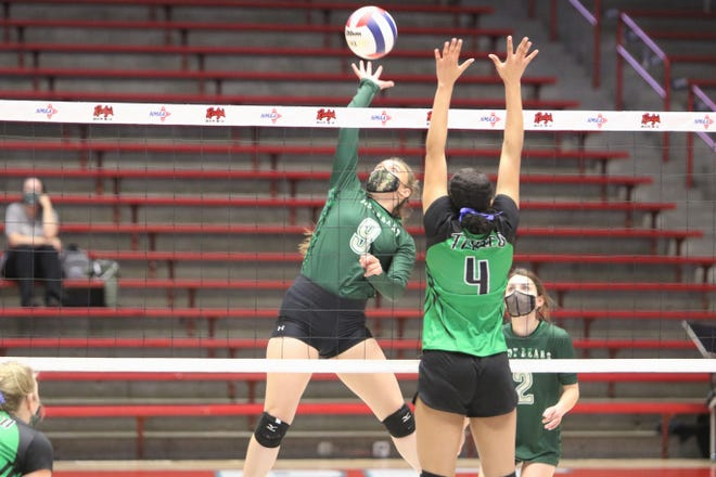 Cloudcroft's Kaylee Hickman hits the ball against Texico's Jalissa Harrison (4) during the 2A state volleyball championship match on Friday, April 2, 2021, at UNM's The Pit in Albuquerque.