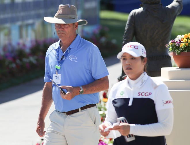 Walking scorer Mark Whichard walks with Ariya Jutanugarn after she finished the 18th hole during the ANA Inspiration at Mission Hills Country Club in Rancho Mirage, April 2, 2021.