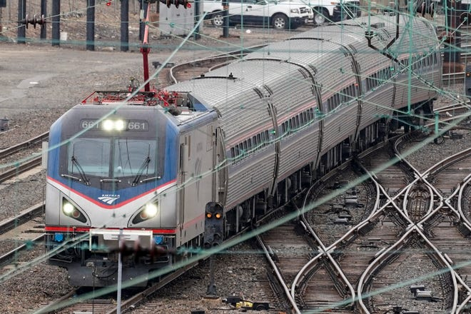 An Amtrak train departs 30th Street Station in Philadelphia, Wednesday, March 31, 2021. Looking beyond the $1.9 trillion COVID relief bill, President Joe Biden and lawmakers are laying the groundwork for another of his top legislative priorities: a long-sought boost to the nation's roads, bridges and other infrastructure that could meet GOP resistance to a hefty price tag.