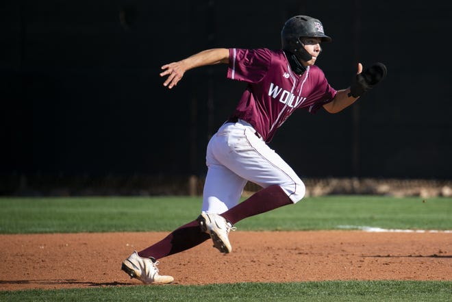Desert Mountain Wolves Senior Wes Kath returns to first base after attempting to steal second during a game agains the Gilbert Tigers at Desert Mountain High School in Scottsdale, Ariz. on Mar. 11, 2021.