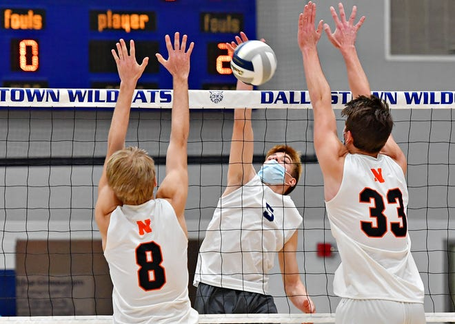 Dallastown's Willem Del Priore, center, hits the ball across the net while Northeastern's Zach Johnson, left, and Joel Braswell defend during boys' volleyball action at Dallastown Area High School in York Township, Thursday, April, 1, 2021. Dallastown would fall to Northeastern 3-0. Dawn J. Sagert photo