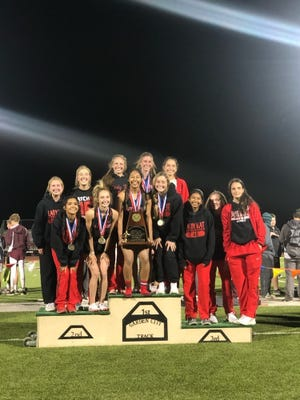 The Garden City High School girls track and field team celebrates a District 8-1A championship Thursday, April 1, 2021 in Garden City