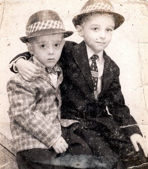 Columnist Steve Pokin, left, and older brother Jim are looking dapper in their jackets and fedoras.