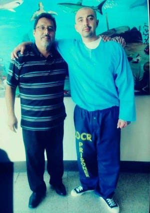 Ignacio Ixta Sr. poses for a photo with his son Ignacio Ixta Jr. while visiting him in state prison. Ixta Jr. was expected to have his 2010 Oxnard attempted murder conviction set aside April 12.