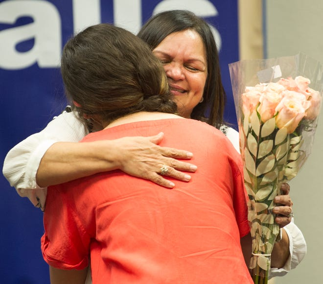 Retiring Wichita Falls police officer Betty Dean received hugs and well-wishes during a retirement ceremony held Friday morning.