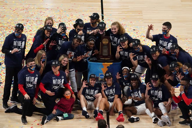 Arizona Wildcats players pose with the regional champion trophy after an Elite Eight game against the Indiana Hoosiers in the 2021 Women's NCAA Tournament.