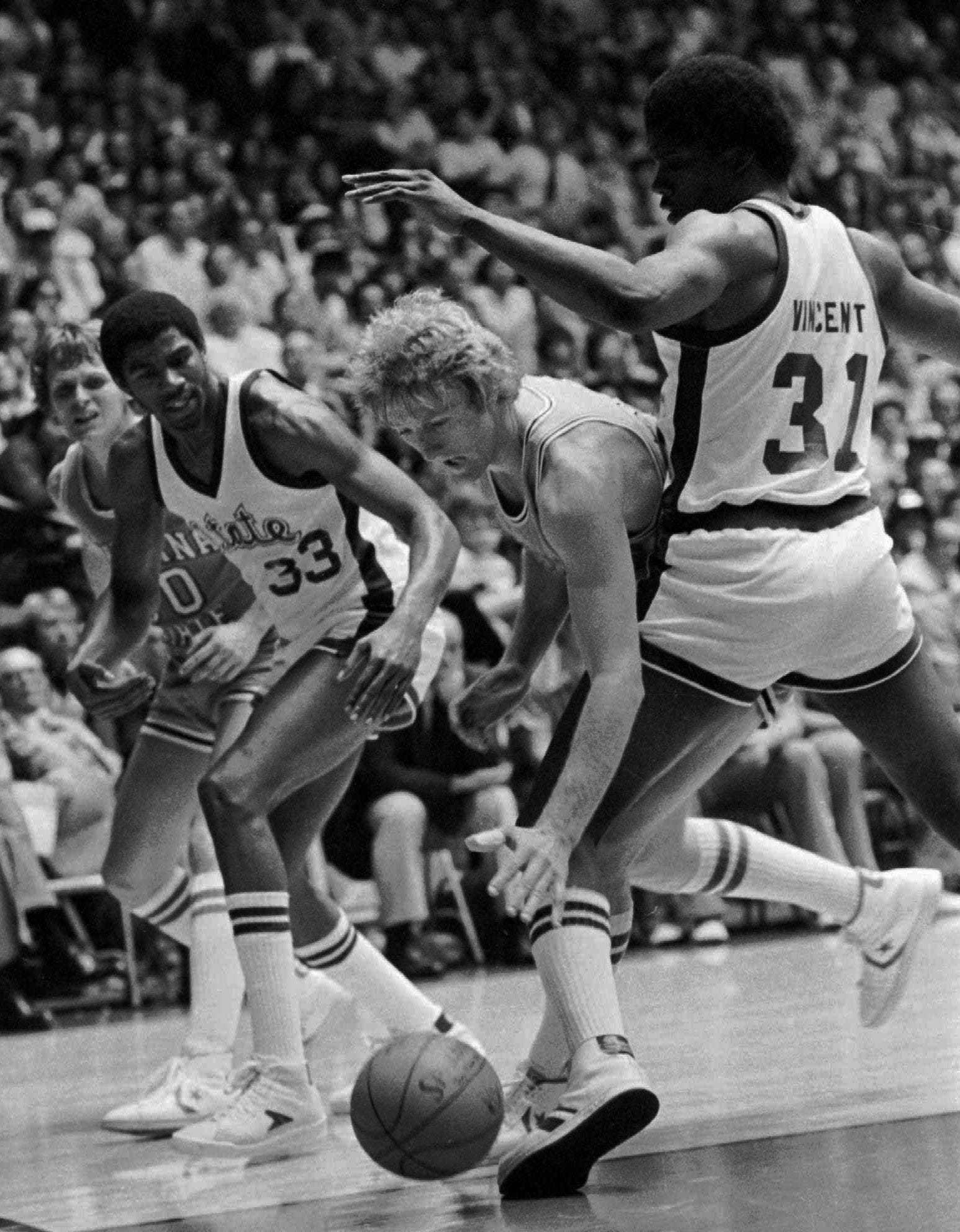 Michigan State's Jay Vincent (31) and Earvin Johnson apply pressure as Indiana State's Larry Bird looks for help during their NCAA championship game in 1979.