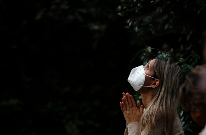 April 1, 2021: A woman attends Mass outside the Schoenstatt shrine during Easter in Buenos Aires, Argentina.