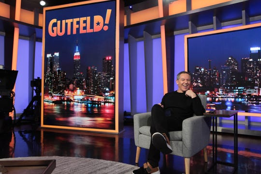 Greg Gutfeld gets comfortable on the new set for his Fox News late-night show, 'Gutfeld!'
