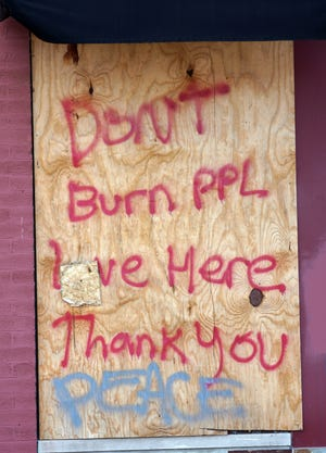Plywood covers windows that were destroyed during riots following the death of George Floyd in Minneapolis. Messages like this were common at the time, posted in hopes of sparing specific buildings from arson.