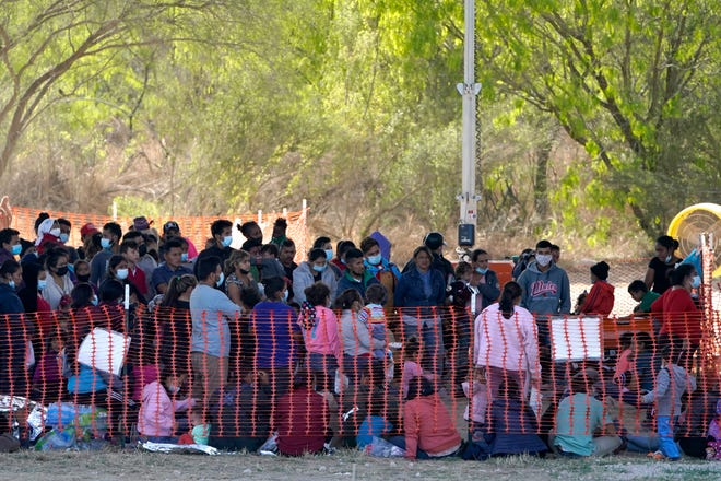 Migrants are seen in custody at a U.S. Customs and Border Protection processing area under the Anzalduas International Bridge, Friday, March 19, 2021, in Mission, Texas.