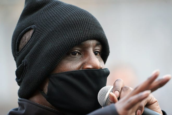 Trahern Crews of BLM Minnesota speaks to the crowd at a protest outside the Minneapolis courthouse where a jury is now hearing the case against former Minneapolis police Officer Derek Chauvin, who is accused of killing Floyd, sparking a wave of protests and riots nationally.