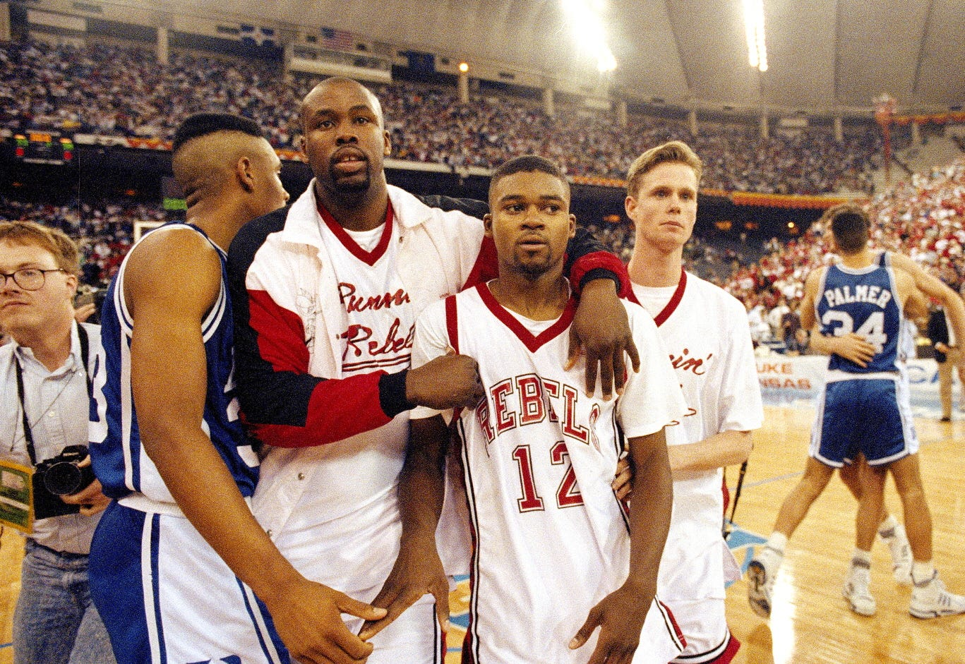 UNLV's Anderson Hunt (12) and teammates leave the floor after losing to Duke in the NCAA national semifinal game in 1991.