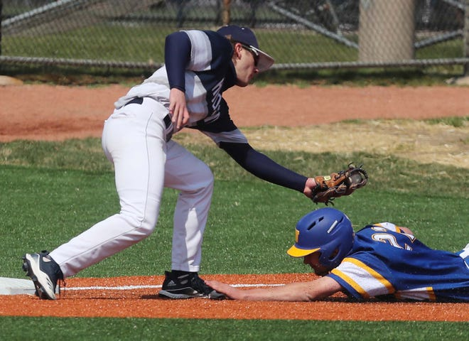 Hudson third baseman Johnny MacKay tags Wooster's Elisha Steiner out at third during the sixth inning of their game at Hudson High School Saturday, April 3, 2021 in Hudson, Ohio. Wooster won 10-7.