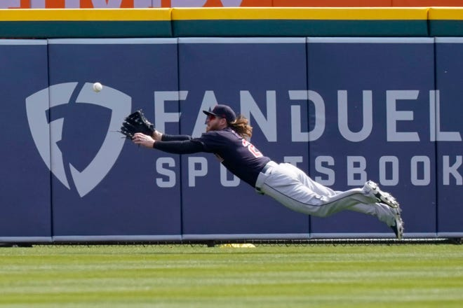 Cleveland center fielder Ben Gamel stretches but can't reach a triple hit by Detroit Tigers' Willi Castro during the first inning of the Tigers' 5-2 win Saturday. [Carlos Osorio/Associated Press]