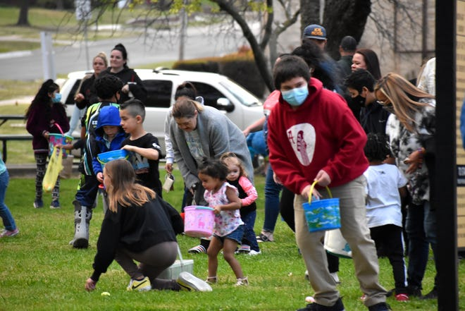 Families run through Central Park during an Ardmore FOP Easter Egg Hunt Friday, April 2, 2021.