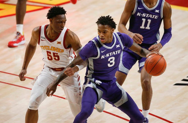 Kansas State sophomore guard DaJuan Gordon moves the ball inside against Iowa State's Darlinstone Dubar on Dec. 15 at Hilton Coliseum in Ames, Iowa.
