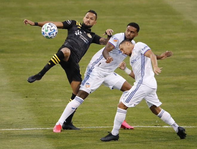 Crew midfielder Artur kicks the ball around FC Cincinnati forward Jurgen Locadia on Sept. 6. Despite pain, Artur was steady all season, playing in 22 of 23 games and playing a full 90 minutes in 18 of 20 starts.