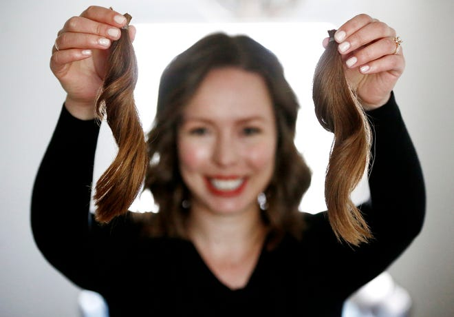 Recently, Ann Mulvany chopped off a 12-inch ponytail to donate to a nonprofit that makes wigs. She packaged up two of her ponytails at her home on Saturday to send to the group.