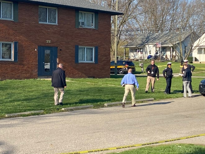 Columbus police investigate scene of a triple shooting Saturday afternoon at an apartment complex in the 900 block of Eaton Avenue, where two men were killed and a third was left in critical condition. Police are adding three people to the homicide unit and creating a fourth shift to help deal with the surge in homicides this year.