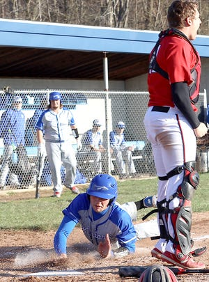 Buckeye Trail sophomore Garrett Burga slides across the plate for a second inning run during Friday's Inter-Valley Conference baseball match-up with visiting Hiland in Old Washington. Burga finished with a double and single and a pair of runs scored in the Warriors' 15-2 loss.