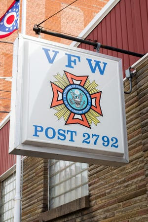 A vintage, weathered sign hangs outside of the Barnesville VFW Post 2792 building.