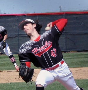 Hiland starting pitcher Casey Lowe fires in game one of the Hawks' doubleheader win over West Holmes. Lowe picked up a five-inning shutout.