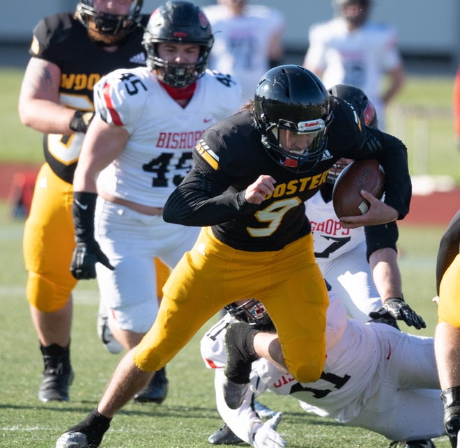 Wooster QB Mateo Renteria scrambles during the Scots' loss to Ohio Wesleyan. Renteria threw for 243 yards and a score and ran for two more TDs.