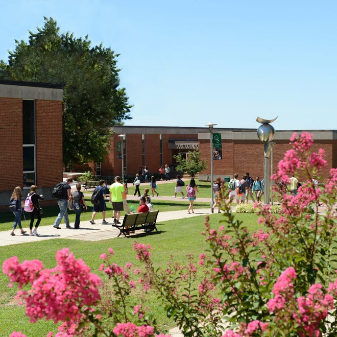 Students walk through the Columbia State Community College campus in Columbia, Tennessee.