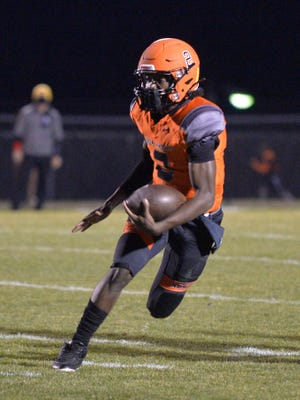 North Davidson quarterback Tedric Jenkins threw for three touchdowns and ran for another in the Black Knights' 55-7 win over Lexington on Friday. [File photo/Mike Duprez]