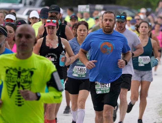 Hundreds of people participate Saturday morning in the Tomoka Half Marathon race at Gemini Springs in DeBary. The annual Tomoka Marathon returns after skipping last year because of the pandemic but moved westward to DeBary.