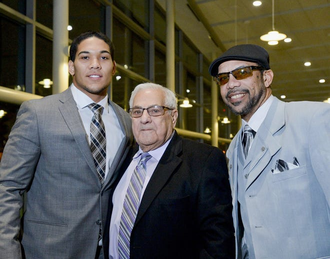 Art Arkelian, center, poses with James Conner of the University of Pittsburgh, left, and Earnest Byner, former Cleveland Browns running back, on Feb. 12, 2015, during the 51st annual Charity Sports Banquet at the Bayfront Convention Center in Erie, PA.