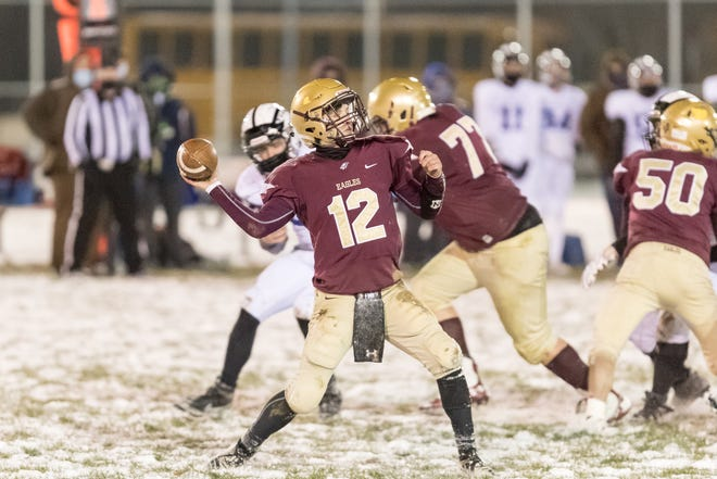 Wayland-Cohocton quarterback Thomas Mead launches a pass Thursday night against visiting Haverling.