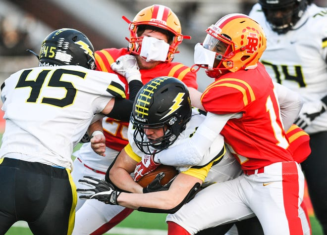 Galesburg's Alex Egipciaco (32) fights for extra yardage against Rock Island's Jamere Burrage (14) during their game at Almquist Field on Friday, April 2, 2021, in Rock Island.