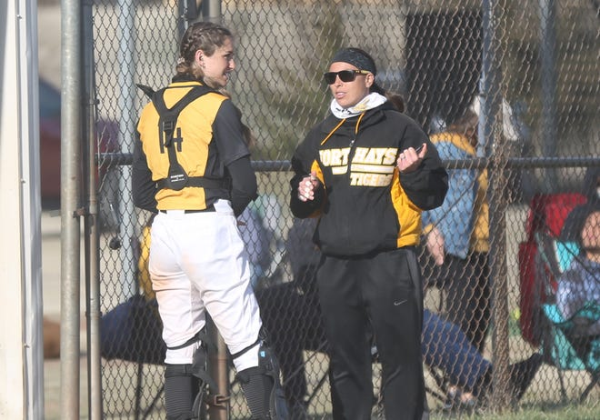FHSU coach Adrian Pilkington talks to Sara Breckbill between innings during Friday's game with Pittsburg State.
