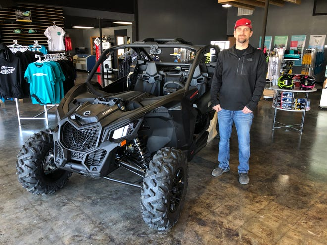 Bill Briney, owner of Briney Motorsports LLC, 1000 E. U.S. Highway 40 Bypass, on the showroom floor on Friday with the sport version of a side-by-side that retails for $19,800.