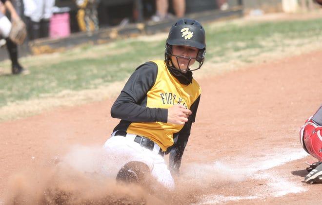 FHSU's Sara Breckbill slides in for a run earlier this season. [File photo/HDN]