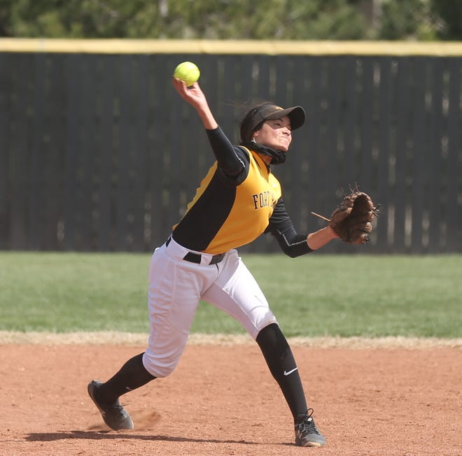 FHSU's Lily Sale throws over to first base in a game earlier this year.