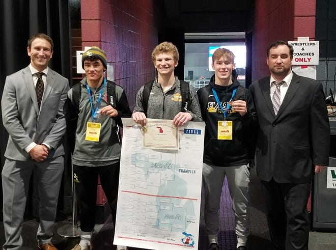 Zeeland East's Carter Hinson celebrates his state title with his All-State teammates, left to right, assistant coach Christopher Heald, Noah Ledford, Hinson, Marty Landes, and coach Marty Landes.