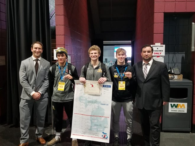 Zeeland East's Carter Hinson (middle) celebrates his state title with all-state teammates Marty Landes (right), coach Marty Landes (far right), Noah Ledford (left) and assistant  Christopher Heald (far left)