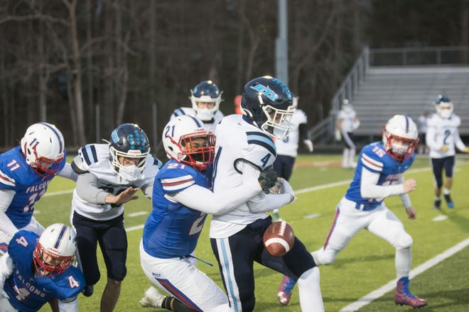West Henderson's Trey Gilliland strips the ball while tackling the Enka runner in Friday's game at West.