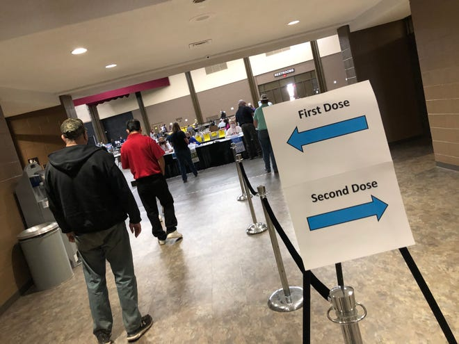 There was a steady flow of people going into the Lubbock Memorial Civic Center Thursday afternoon during the city's COVID-19 vaccination clinic.