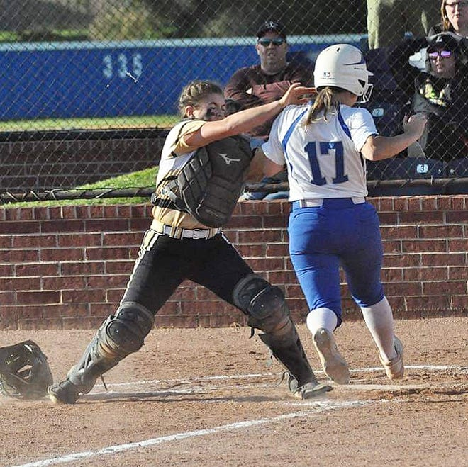 Leesville catcher Mackenzie Waldrop (left) tags out DeRidder's Emma Barbee (17) at the plate during the Lady Dragons' 12-11 win Thursday over the Lady Cats.