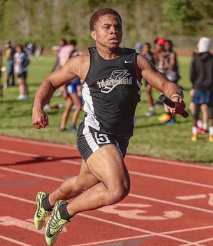 Leesville junior Caleb Gallashaw takes off on his leg of a relay race during a recent meet. Gallashaw won both the 100 and 200-meter dashes at Thursday's Wampus Cat Relays.