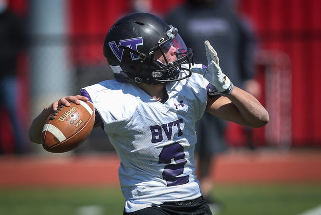 BVT junior quarterback Josh Mateo passes to an open receiver during the football game against Nipmuc at Milford High School on April 3, 2021.