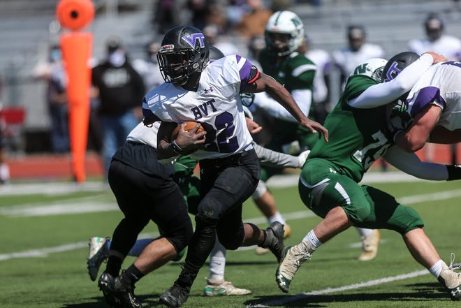 BVT senior captain Carl Muanya picks up the first down during the football game against Nipmuc at Milford High School on April 3, 2021.