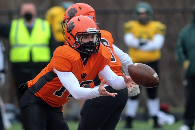Marlborough senior quarterback Jason Short tosses the ball to a running back during the game against Tantasqua Regional at Whitcomb Middle School in Marlborough, April 2, 2021. The Panthers fell to Tantasqua in double-overtime, 29-21.